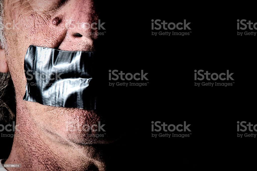 duct tape over mouth of man stock photo