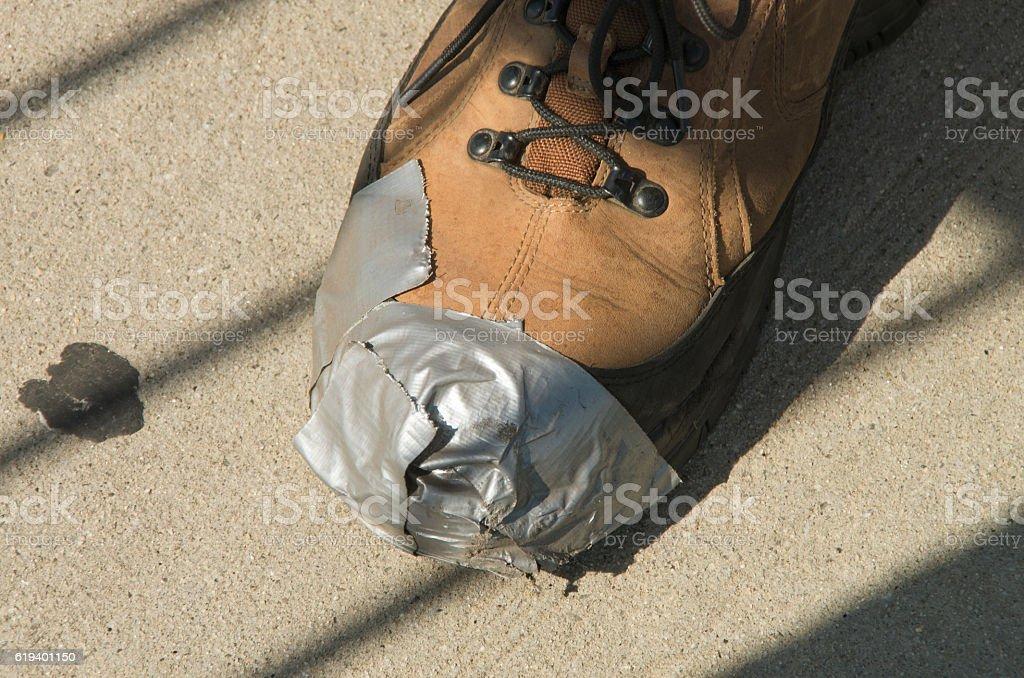 Duct Tape Shoe Repair stock photo
