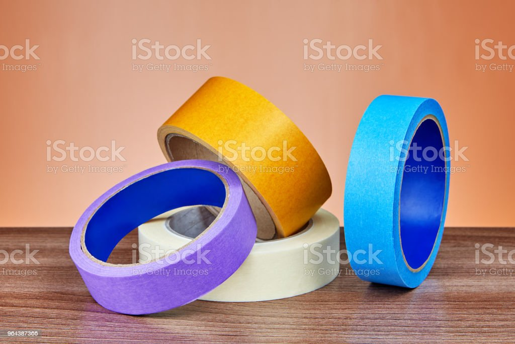 Duct tape, yellow multi-purpose and paper ribbon for painter. stock photo