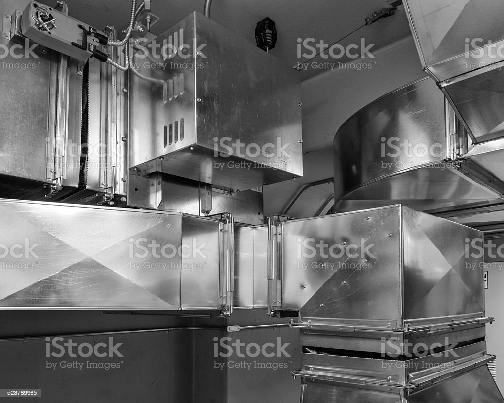 Ductwork with damper actuator stock photo