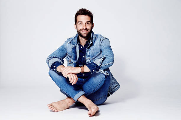 dude all over denim - sitting on floor stock photos and pictures