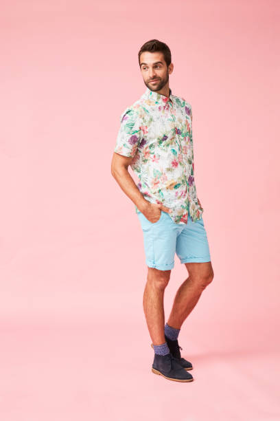 Dude in floral shirt Dude in floral shirt and shorts, studio shorts stock pictures, royalty-free photos & images