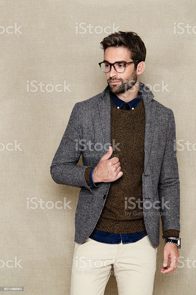 Dude in jacket and spectacles, looking away foto stock royalty-free