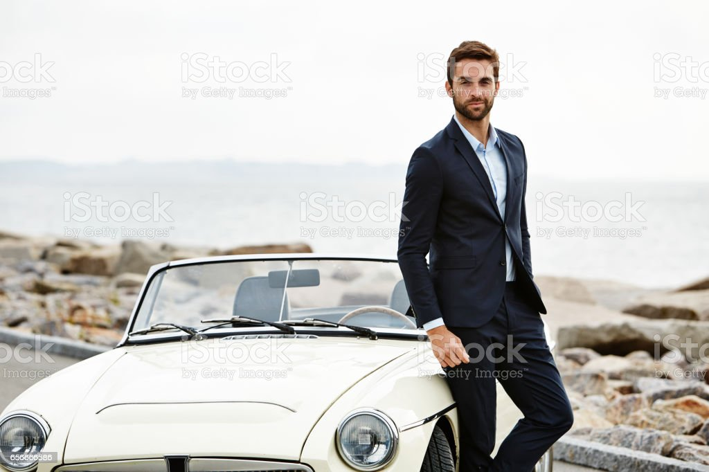 Dude with cool car stock photo