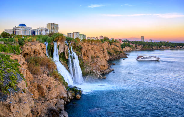 Duden coast waterfalls, Antalya, Turkey, on sunset stock photo