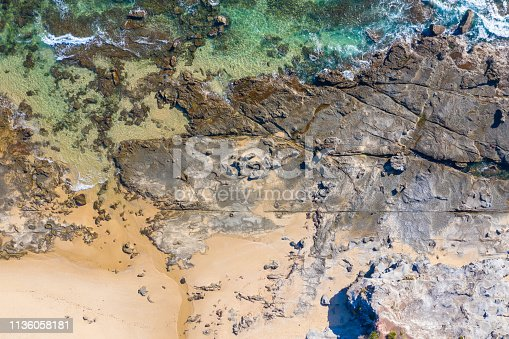 Straight down view of the rocky coastline at Dudley Beach - Newcastle Australia