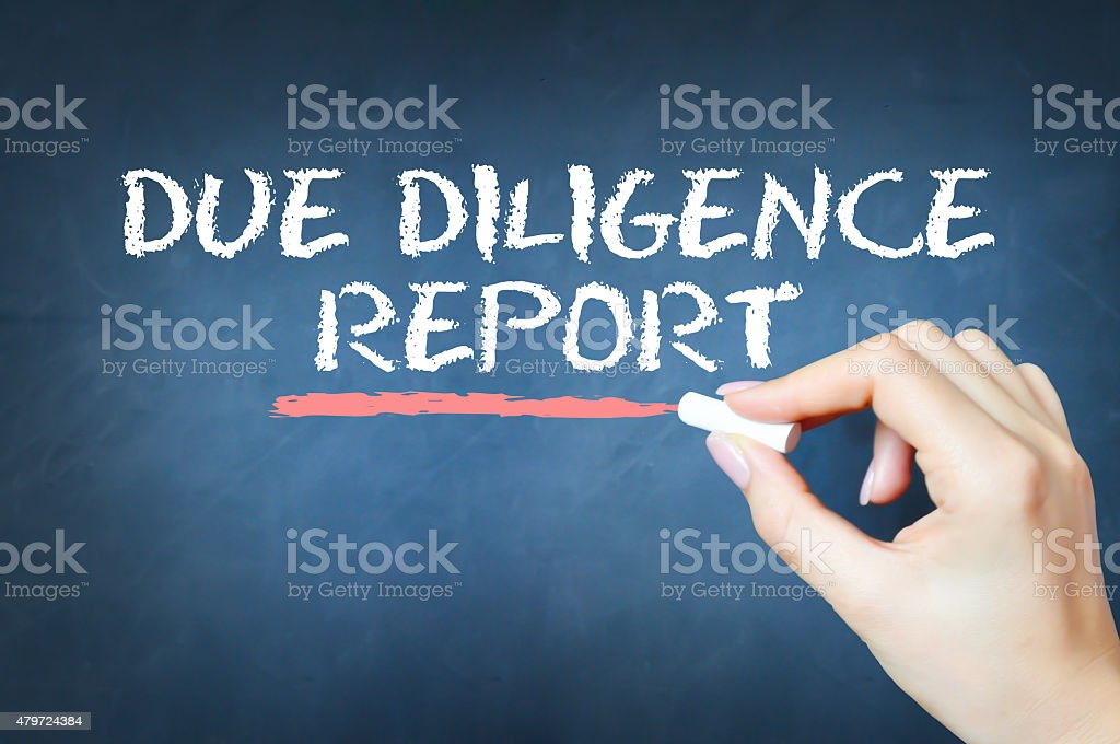 Due diligence report text written with chalk on blackboard stock photo