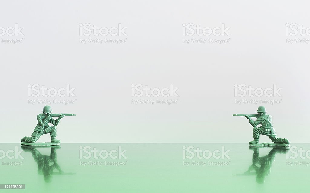 Duel of toy soldiers stock photo