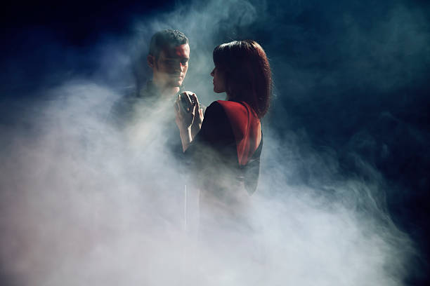 Duet Man and Woman with Microphone stock photo