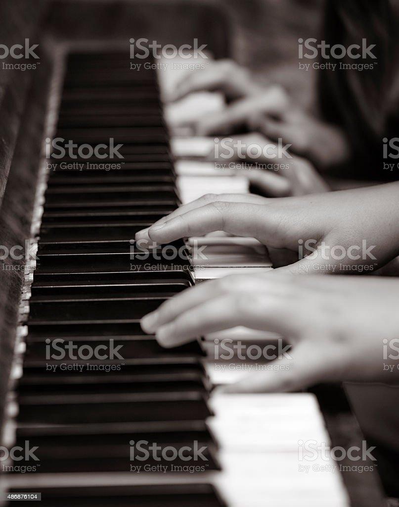 Duet Piano. Hands on Piano Keys stock photo