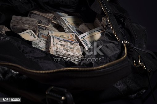 istock Duffel bag bag with cash 807410060