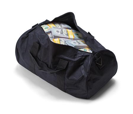 Full Black Duffel Bag of Hundred Dollar Bills Isolated on a White Background.