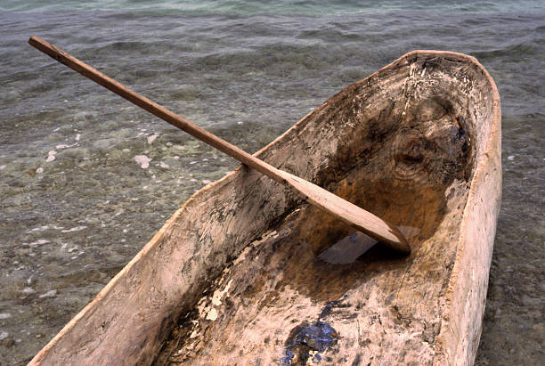 Dugout Log Wooden Canoe with Paddle - Haiti, West Indies stock photo