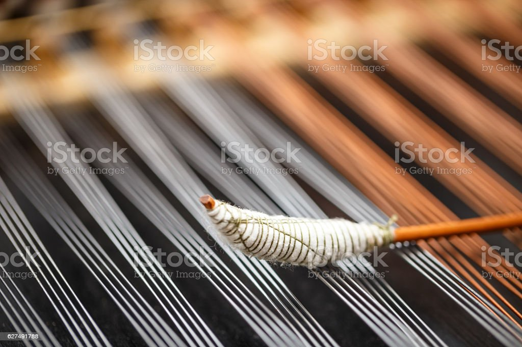 Dulcimer string and wooden bat stock photo