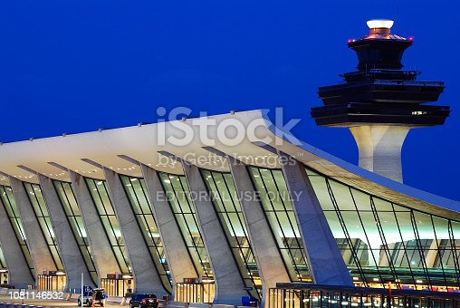 lChantilly, VA, USA June 17, 2011 The air control tower rises over the swooping, curved roof of the Main Terminal Building at Washington Dulles Airport in Chantilly, Virginia