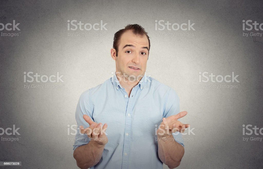 dumb clueless funny looking young man arms out asking what do I do now gesturing stock photo