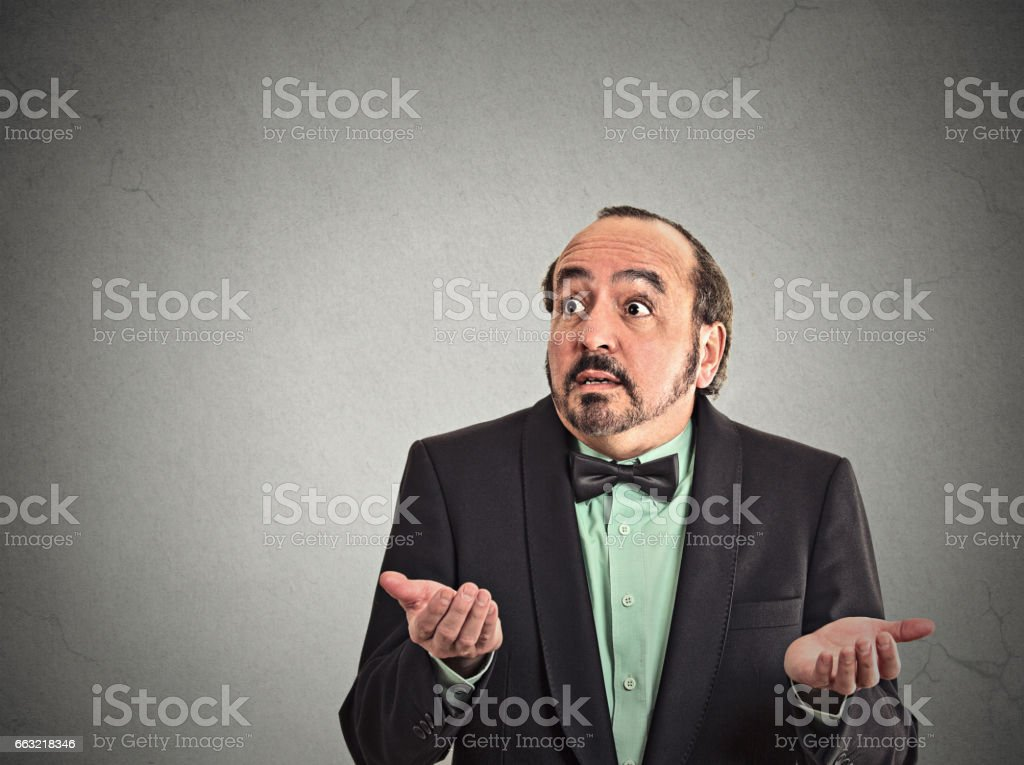 dumb clueless middle age man arms out asking what's the problem stock photo