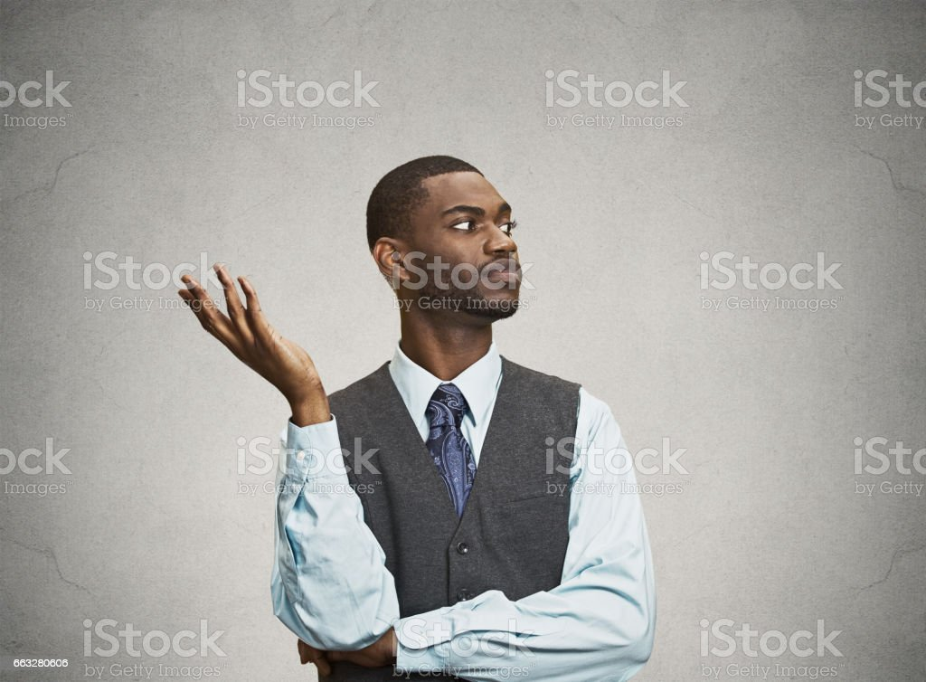 dumb clueless young executive man, arm out asking why stock photo