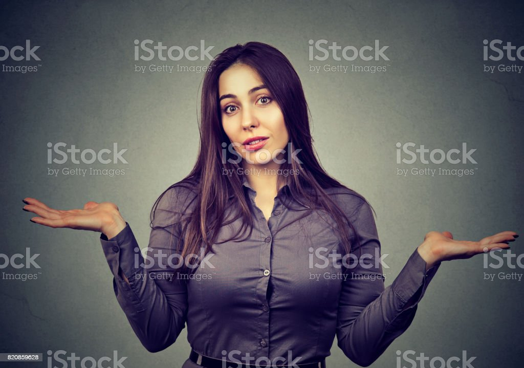 Dumb looking woman arms out shrugs shoulders stock photo