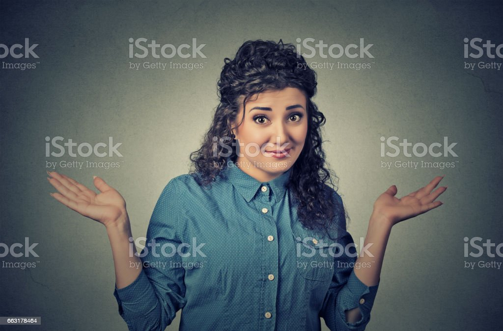 dumb looking woman arms out shrugs shoulders who cares stock photo