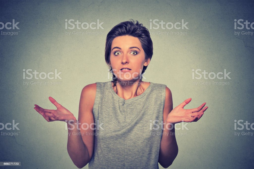 dumb looking woman arms out shrugs shoulders who cares so what I don't know stock photo