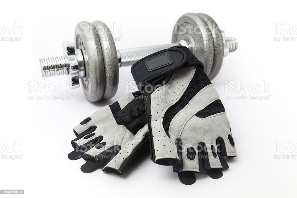 Dumbbell and Fitness Gloves on white background stock photo