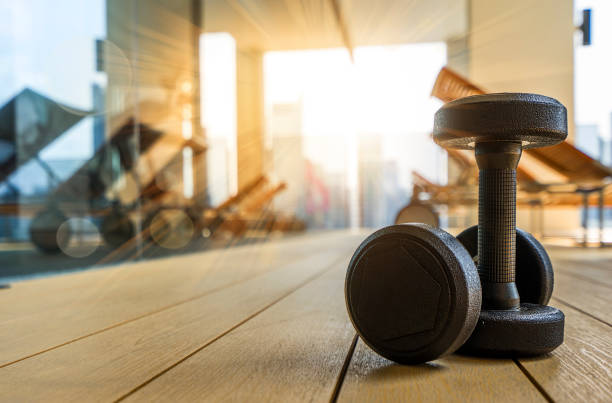 dumbbell in fitness room at the morning - health club stock photos and pictures