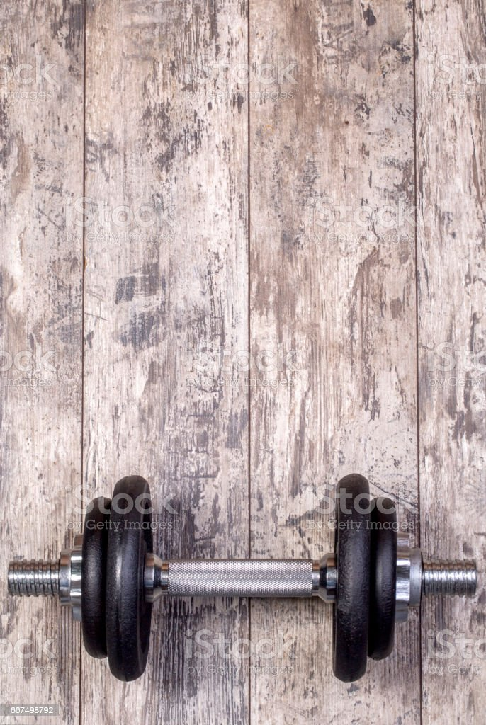 Dumbbell on a wooden background foto stock royalty-free
