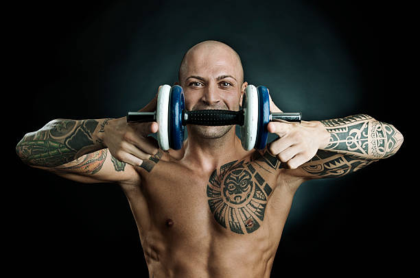 Tattoo Stock Photos: Royalty Free Dumbbell Tattoo Pictures, Images And Stock
