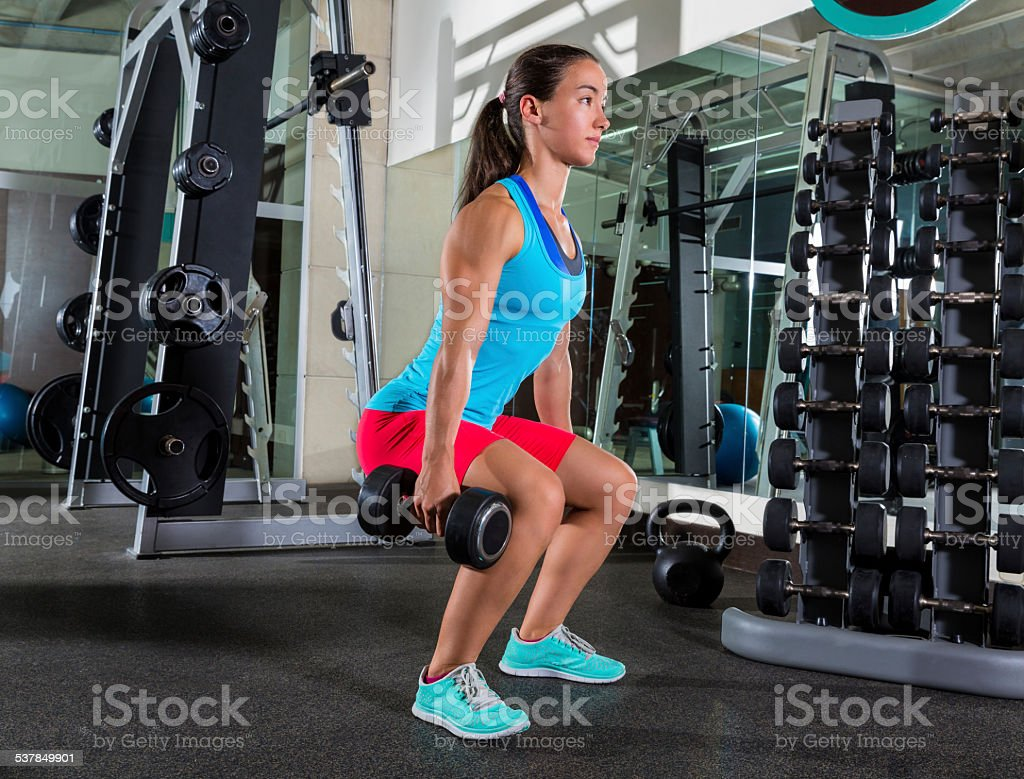 dumbbell squat woman workout at gym stock photo