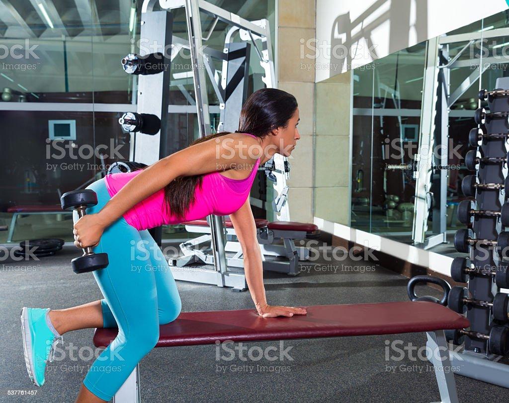 dumbbell triceps kickback girl exercise at gym stock photo