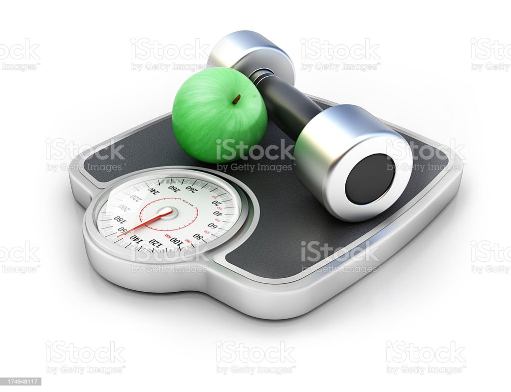 Dumbbell with weight scale and apple stock photo