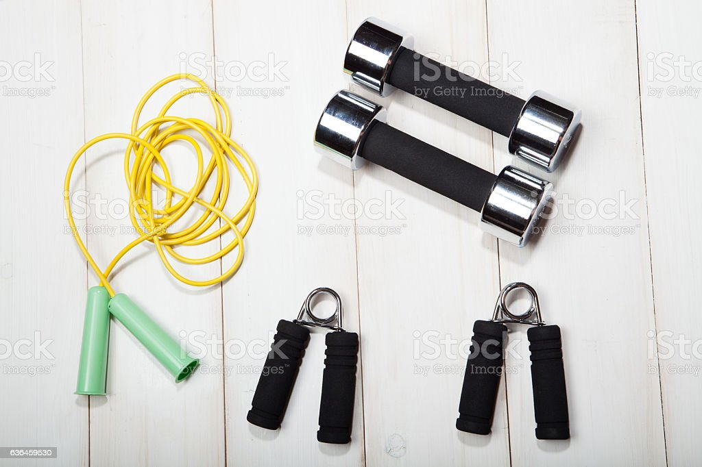Dumbbells, a skipping rope and the expander stock photo