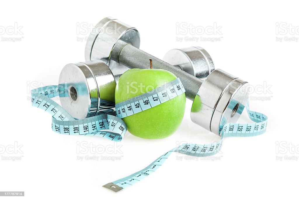 Dumbbells and apple. A healthy way of life royalty-free stock photo