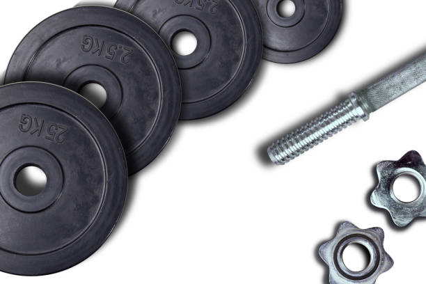 Dumbbells and weights are lying on the floor in the gym. Barbell set and gym equipment. Metal loads in the fitness club – zdjęcie