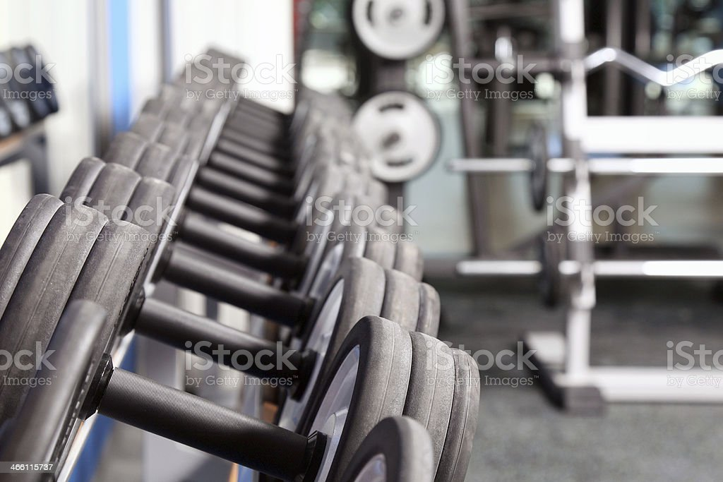 Dumbbells in fitness center stock photo