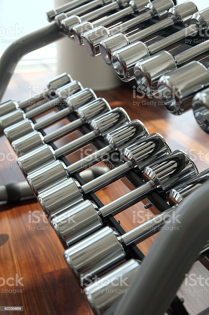 Dumbbells in fitness center royalty-free stock photo