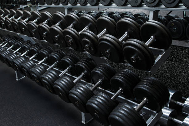 dumbbells in gym - weights stock photos and pictures