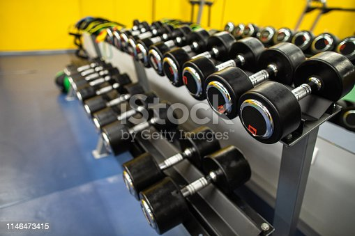 Close up of Dumbbells in the modern empty Gym