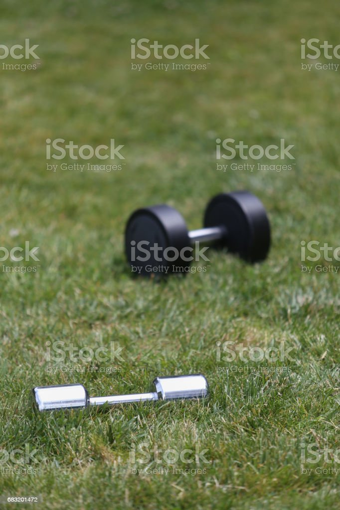 dumbbells on grass.outdoor training 免版稅 stock photo
