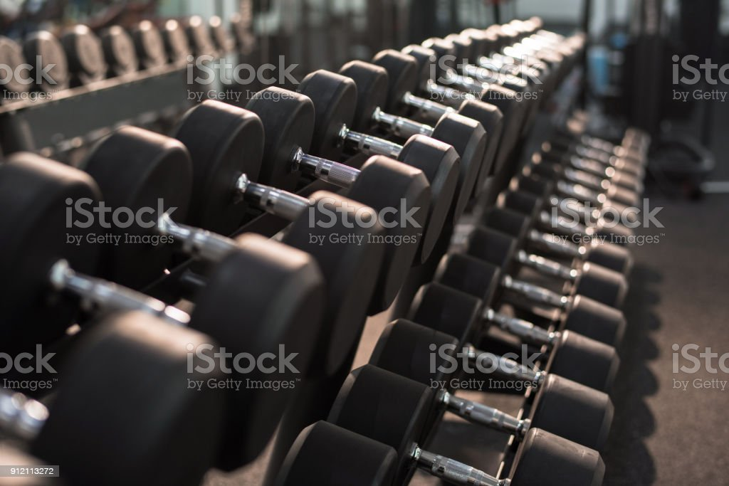 Dumbbells on Stand in Gym stock photo