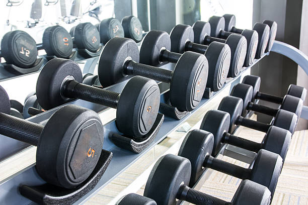 dumbbells - weight stock photos and pictures