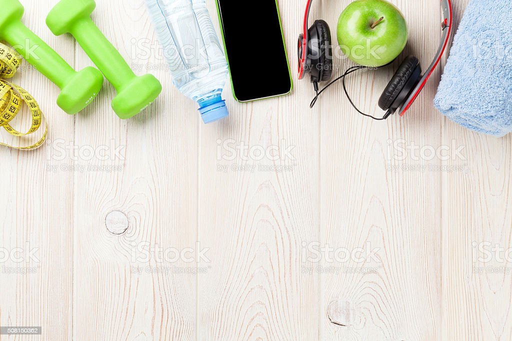Dumbbells, water and music stock photo