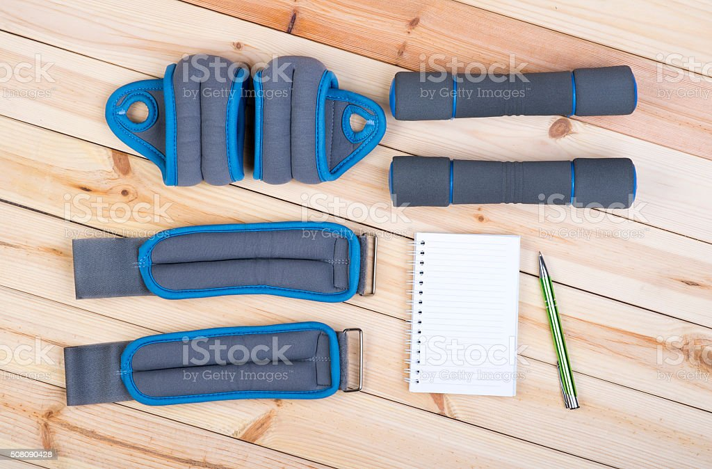 Dumbbells, Weights And Notepad. stock photo