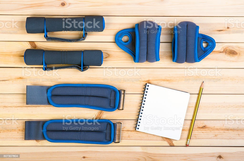 Dumbbells, Weights, Notebook. stock photo