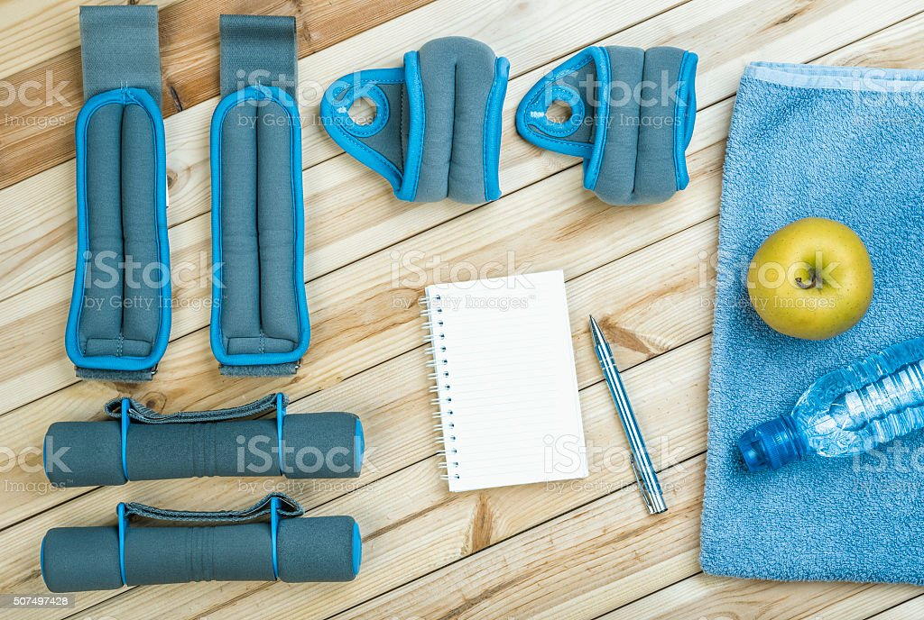 Dumbbells, Weights, Towel, Water, Notebook. stock photo