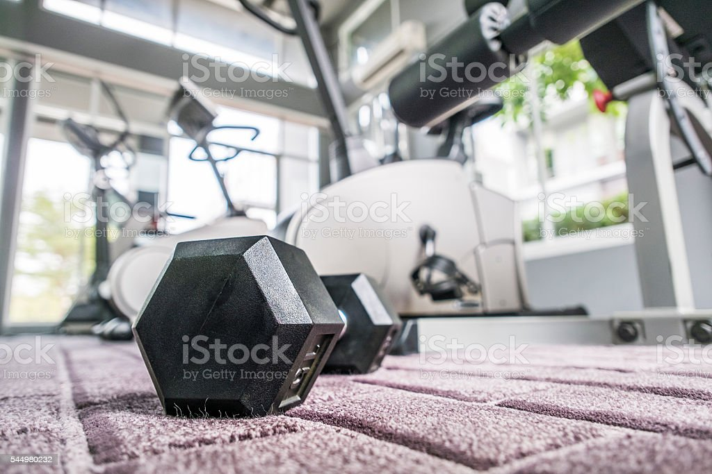 Dumbell in fitness room stock photo