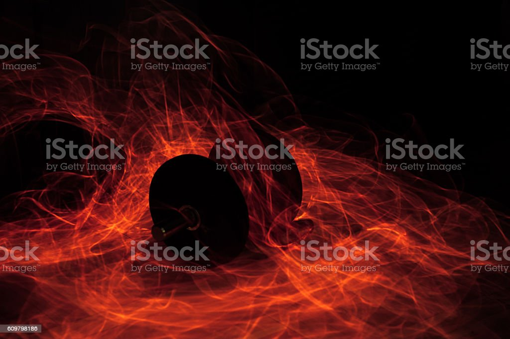 Dumbell on fire stock photo