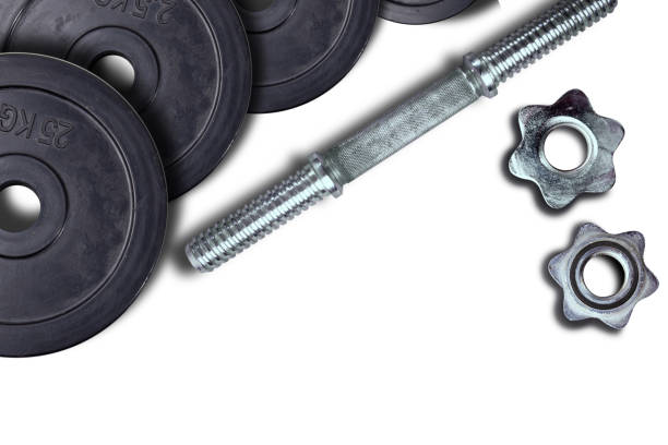 Dumbells and weights on a white background. Fastening screws and barbells. – zdjęcie