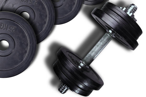 Dumbells and weights on a white background. – zdjęcie